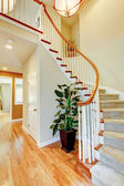 Curved staircase with hallway and hardwood floor. — Foto de Stock
