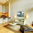 Stock Photo: Modern loft apartment living room interior with kitchen.