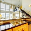 Loft modern apartment with wood kitchen and staircase. - ストック写真