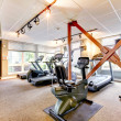Gym in apartment building with mirror. - Stok fotoğraf