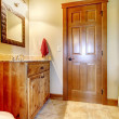 Large bathroom with wood furniture and natural colors. — Stock Photo