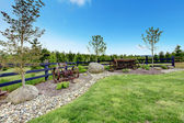 Backyard beautiful spring landscape with fence and forest. — Stock Photo