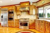 Wood luxury home kitchen interior. New Farm American home. — Stock Photo