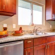 New cherry wood American kitchen interior. — Stock Photo