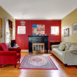 Living room with red and yellow walls and fireplace. — Stock Photo #20843435