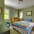 Stock Photo: Kids bedroom with desk and green walls.