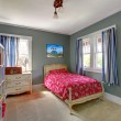 Stock Photo: Kids bedroom with red bed and grey walls.