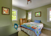 Kids bedroom with desk and green walls. — Stock Photo