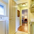 Laundry room with open door to bedroom. — Stock Photo #21772191