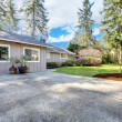 Royalty-Free Stock Photo: Brown grey house exterior with large driveway.