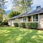 Brown grey house exterior with spring backyard. — Stock Photo