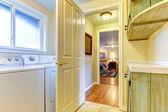 Laundry room with open door to bedroom. — Stock Photo
