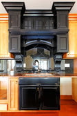 Kitchen island and stove custom wood cabinets. New luxury home interior. — Stock Photo