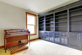 Empty library office room with piano. New luxury home interior. — Stock Photo