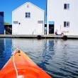Boat house in Tacoma, WA and orange kayak. — Stock Photo #22343525