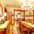 Historical American old house dining room with lots of wood. — Stock Photo