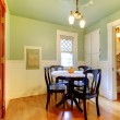 Green antique casual dining room with black table. — Stock Photo