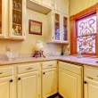 White kitchen pantry with antique cabinets and window. — Stock Photo #22344049