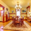 Historical American old house dining room with lots of wood. — Stock Photo #22344055