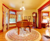 Luxury old American house living room with piano and gold colors — Stock Photo