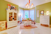 Charming antique baby room with green and white. — Stock Photo