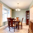 Green dining room interior with classic brown furniture. — Stock Photo
