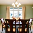 Green dining room interior with classic brown furniture. — Stock Photo #22434751