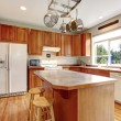 Stock Photo: Classic large wood kitchen interior with hardwood floor.