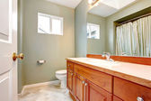 Green clean new bathroom with wood cabients. — Stock Photo