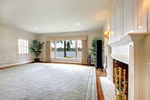 Large historical old living room interior with fireplace and lake view. — Stock Photo