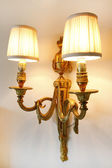 Antique wall light in gold. — Stock Photo
