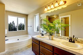 New home bathroom with shower and bath. — Stock Photo