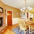 Breakfast dining room area with fireplace near kitchen. — Stock Photo