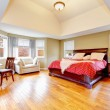 Large master bedroom interior with green alls and hardwood floor — Stock Photo