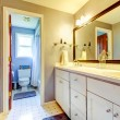 Bathroom with white cabinet and toilet area. — Stock Photo