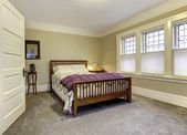 Classic bedroom with brown wooden bed — Stock Photo