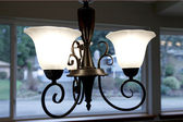Black iron chandilier for kitchen — Photo
