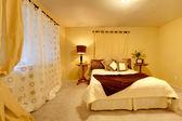 Elegant bright bedroom — Stock Photo