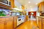 Furnished bright light brown kitchen room — Stock Photo