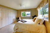 Light tones bedroom with a queen size bed — Stock Photo