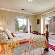 Warm colors bedroom with an old-fashioned bed — Stock Photo #39483311