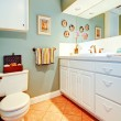 Bright cozy bathroom with white wood cabinets — Stock Photo