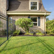 Stock Photo: Beautiful spring fenced backyard with trim