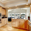 Bright wood kitchen and dining area — Stock Photo