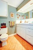 Bright cozy bathroom with white wood cabinets — Photo