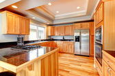 Bright wood kitchen with coffered ceiling — Stock Photo