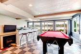 Elegant entertainment room with pool, bar and fireplace — Stock Photo