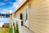 Siding house wiht front deck — Stock Photo
