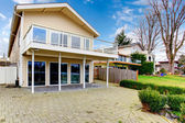 Two story paneled house with glass balcony — Stock Photo