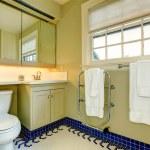 Bright yellow bathroom with blue tile floor — Stock Photo #39665751